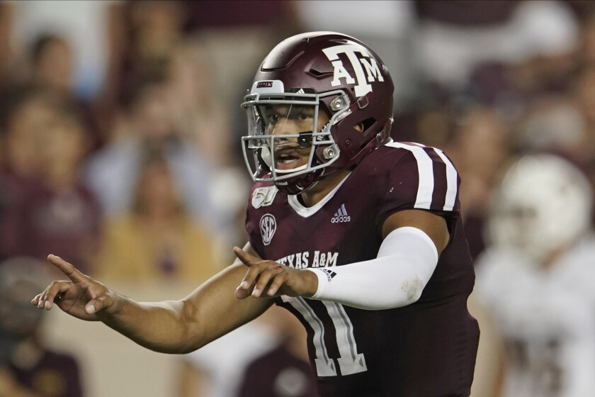 FILE - In this Aug. 29, 2019, file photo, Texas A&M's Kellen Mond (11) directs his team against Texas State during the second half of an NCAA college football game, in College Station, Texas. As Jimbo Fisher enters his third season at Texas A&M he has a luxury afforded to very few coaches: a four-year starter at quarterback in Kellen Mond. Mond is one of the most experienced quarterbacks in the nation this season after starting 36 games in his first three seasons with the Aggies. (AP Photo/Chuck Burton, File)