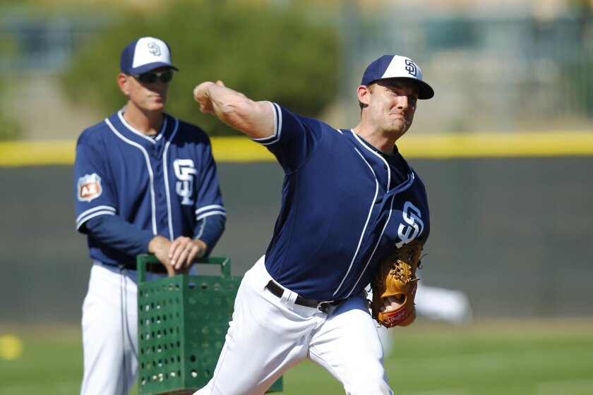 San Diego Padres Philip Humber pitches during a spring training practice.