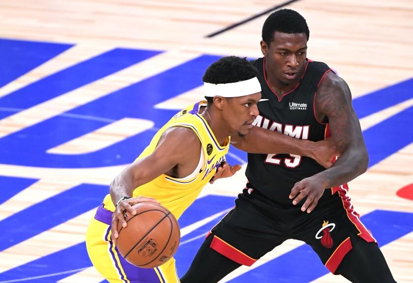 Lakers guard Rajon Rondo drives past Miami Heat guard Kendrick Nunn.