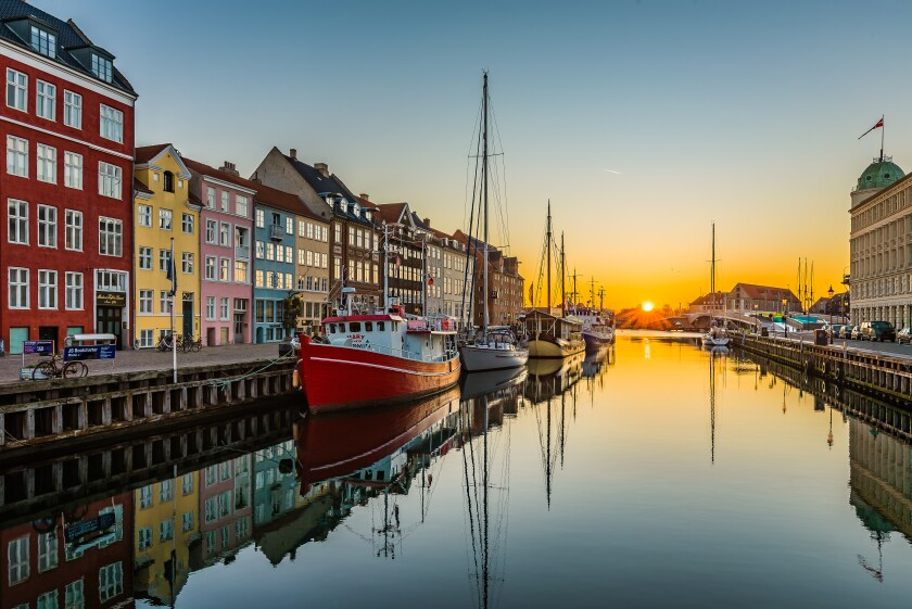 The tranquil water of the Copenhagen harbor Nyhavn an early morning at sunrise