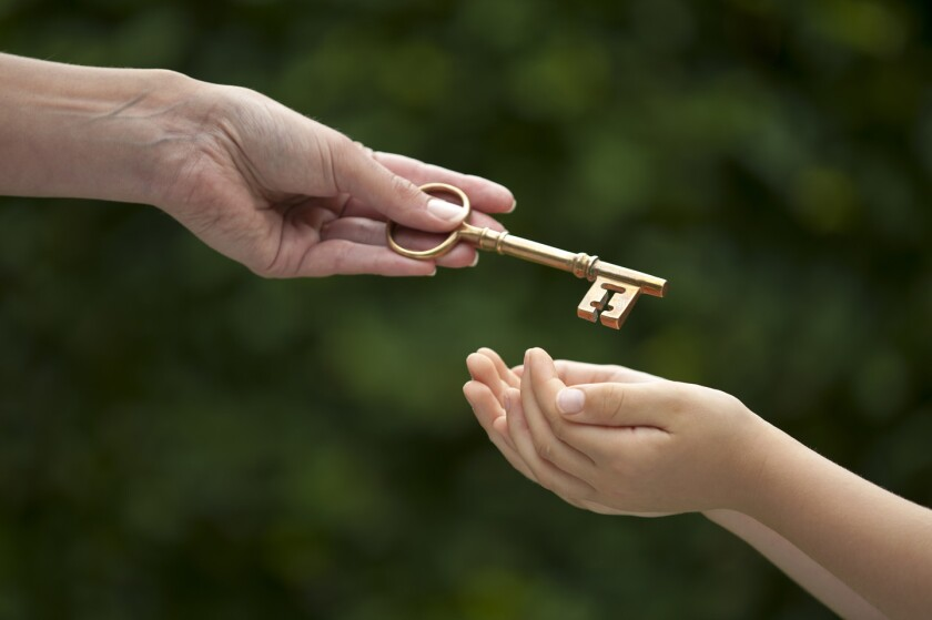 adult hands key to child