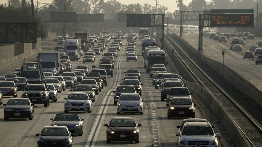 With congestion building in the toll lanes on the 110 and 10 freeways, Metro is ending the free access for commuters who drove alone in plug-in hybrids and electric vehicles.