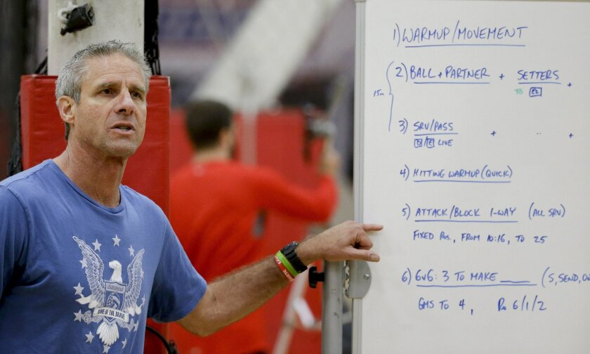 In this Tuesday, May 24, 2016, photo, U.S. coach Karch Kiraly talks to his team during U.S. women's national volleyball practice in Anaheim, Calif. When the U.S. women's volleyball team got together months ago, the coaches embarked on a risky experiment: Evaluate your teammates. It paid off in a st