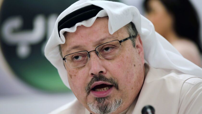Jamal Khashoggi speaks during a press conference in Manama, Bahrain on Feb. 1, 2015.