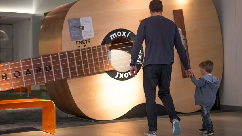 The museum's main floor explores the world of sound. You can step inside a giant guitar to see how it all works.