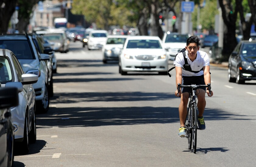 A cyclist rides along Westwood Boulevard in Westwood.