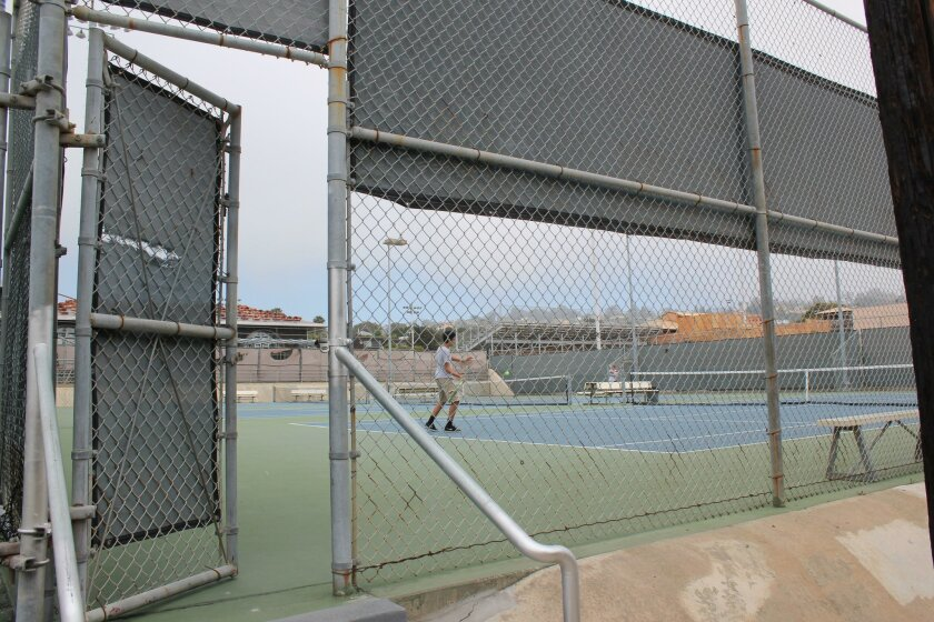 Kids play tennis at the La Jolla High courts, June 3.