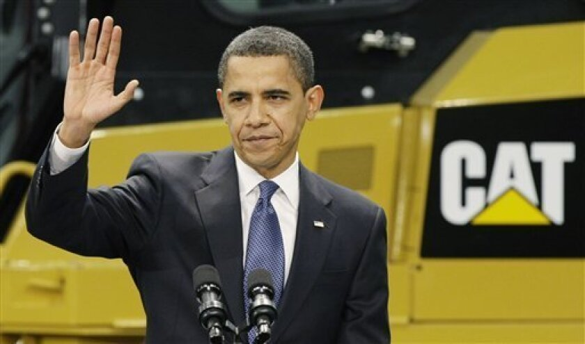President Barack Obama finishes addressing employees at the Caterpillar plant in East Peoria, Ill., Thursday, Feb. 12, 2009. (AP Photo/Charles Rex Arbogast)