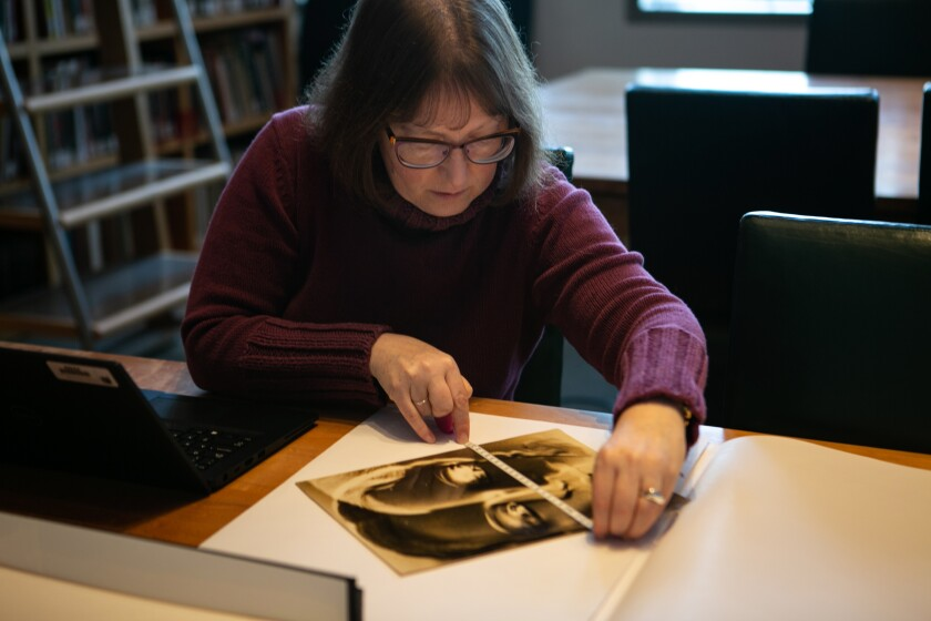 Miriam Katz, collections manager and lead cataloger at the Getty, measures a print.