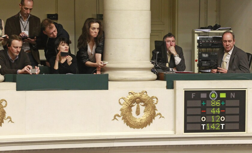 Journalists look at the electronic voting board as Belgian politicians vote in favor of the bill on child euthanasia in Brussels on Thursday.