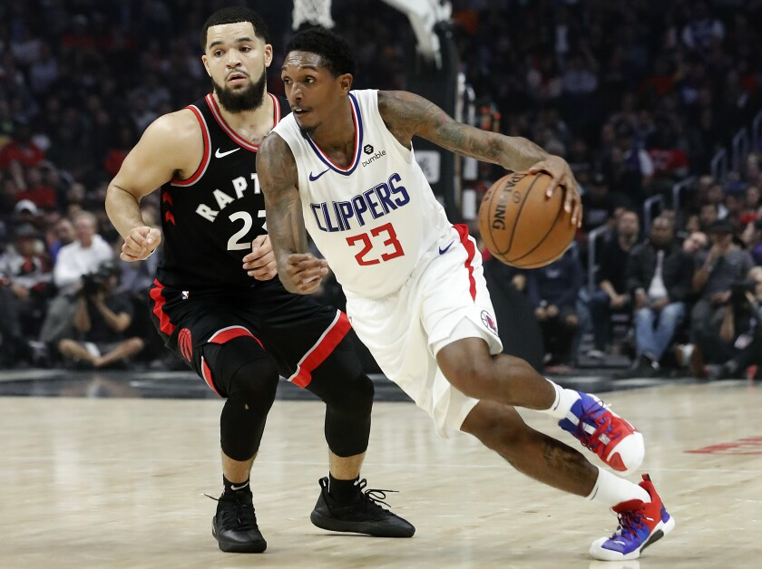 Guard Lou Williams drives to the basket against Fred Vanvleet.