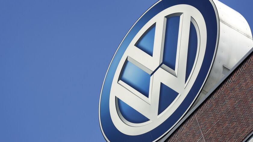 FILE - In this Wednesday, Aug. 1, 2018 photo a logo of the brand Volkswagen is pictured on top of a