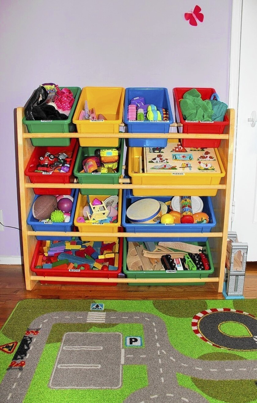 Professional organizer Tanya Whitford has arranged her kids' toys to help them learn early how to put things back in place.