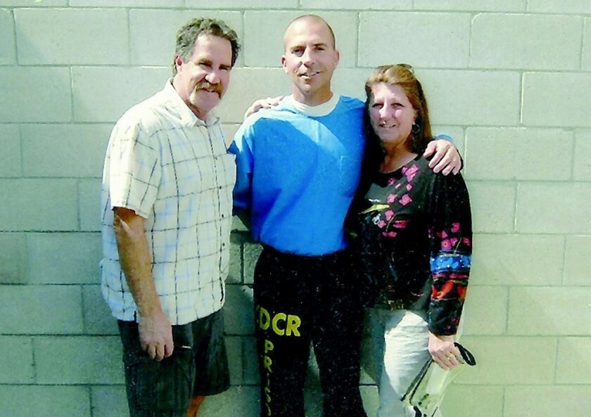 Top: Handout photo from family shows step-father Rick Gambino, mother Mary Gambino visiting Uriah Courtney, center, in prison April 7, 2012. Bottom Uriah Courtney is hugged by his mother and step-father Mary and Rick Gambino as he's released from prison May 6, 2013. Courtesy photo