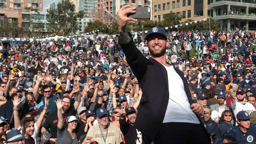 Former Chargers player Nick Hardwick takes a selfie from the stage in front of some of an estimated crowd of more than 12,000 during the Celebrate San Diego Rally at Petco Park on Saturday.