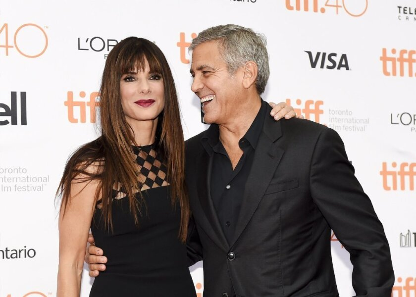 """Sandra Bullock and George Clooney at the Toronto International Film Festival premiere of """"Our Brand Is Crisis."""""""