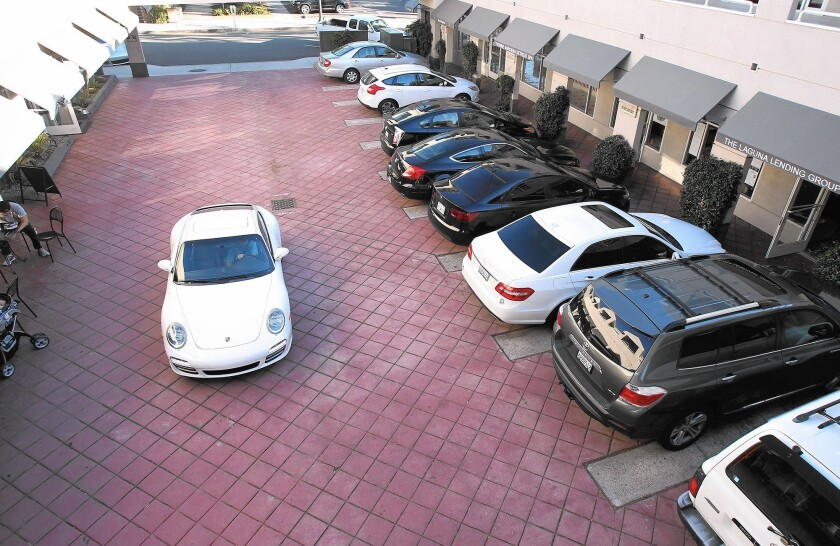 Cars fill every parking space in The Plaza shopping center where Shirley's Bagels customers park.