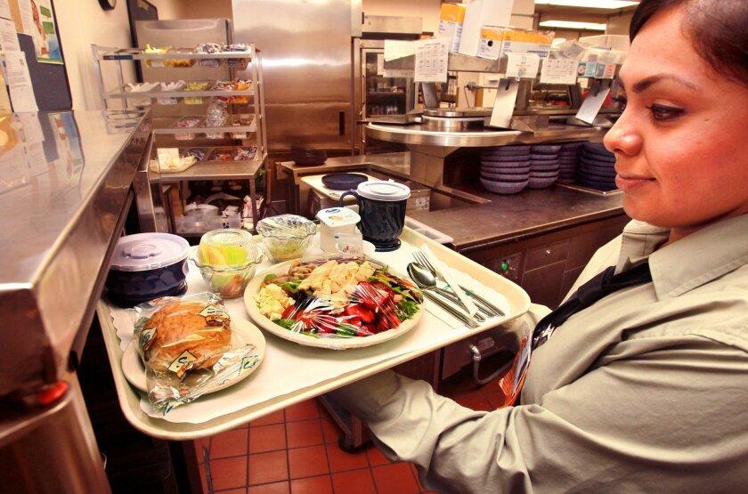 At Pomerado Hospital, Esmeralda Garcia holds a patient dinner featuring an organic vegetable main dish. / photo by Charlie Neuman • U-T San Diego