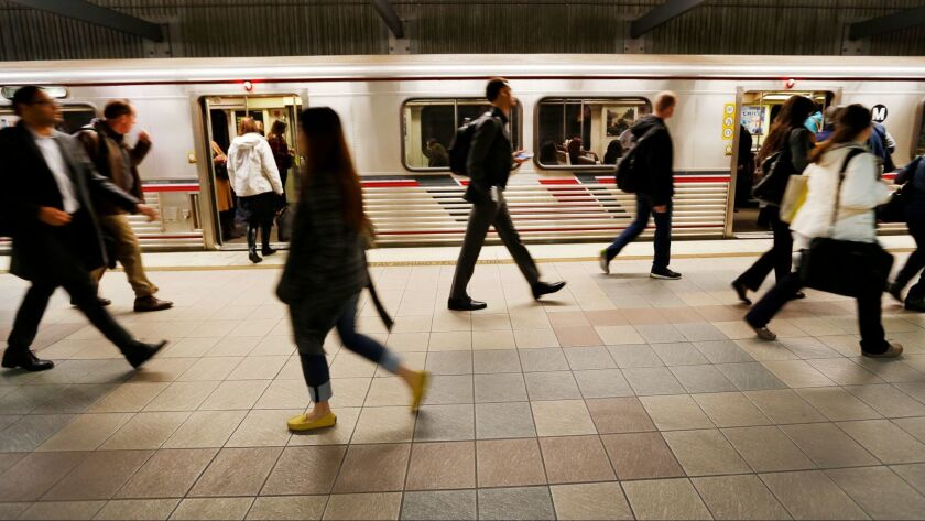 LOS ANGELES, CA - DECEMBER 01, 2016 - Passengers fill the platform of the Metro Red and Purple Line