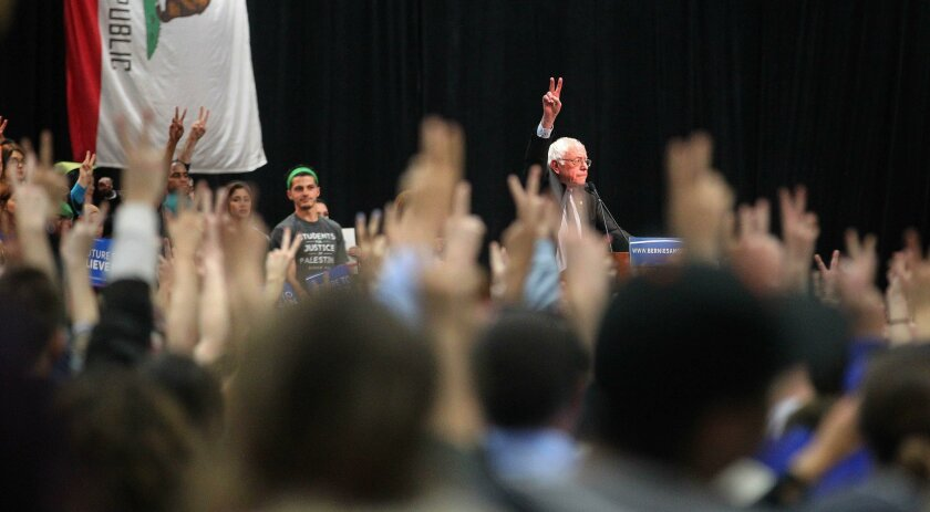 Presidential candidate Bernie Sanders spoke at the Convention Center in San Diego Tuesday night. The peace signs were for the people of Brussels after Tuesday's terrorist attacks.