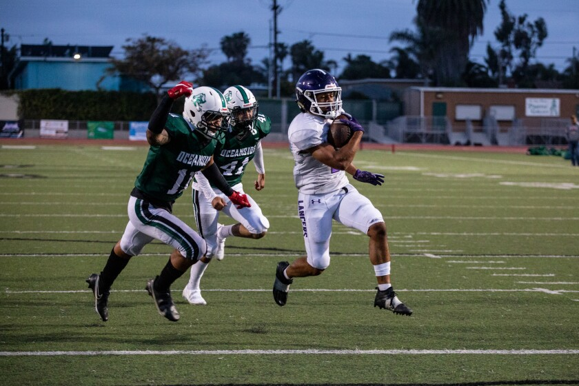 Carlsbad running back Mazlo Norwood scores one of his two touchdowns against Oceanside.