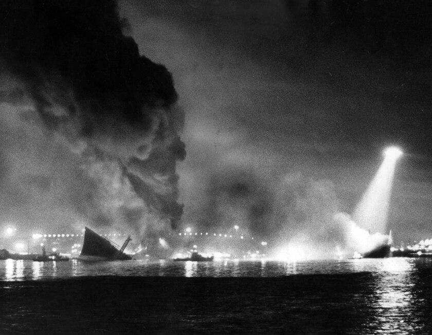 Dec. 17, 1976: Split in two, the 810-foot Liberian oil tanker Sansinena lies burning at San Pedro in