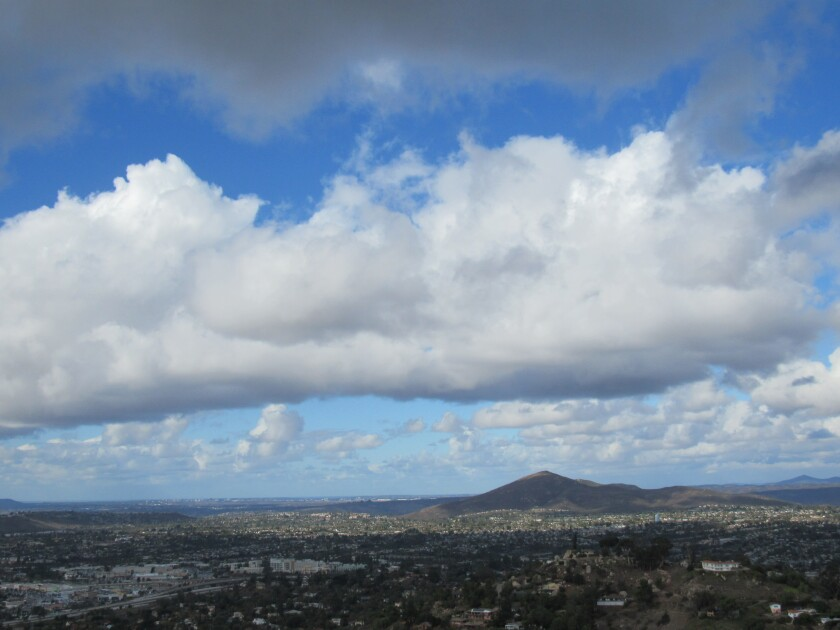 High clouds and clear skies around Cowles Mountain in the city of San Diego as seen from Mount Helix in unincorporated La Mesa on Friday, Nov. 29, the morning after a Thanksgiving Day storm.
