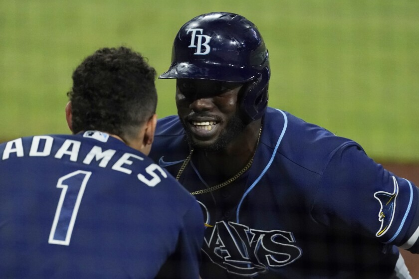 Tampa Bay Rays Randy Arozarena celebrates his two run home run with Rays' Willy Adames during the fourth inning against the Houston Astros in Game 4 of a baseball American League Championship Series, Wednesday, Oct. 14, 2020, in San Diego.(AP Photo/Ashley Landis)