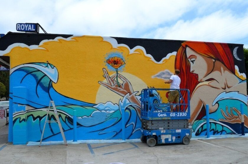 'Remember California' is the title of the mural being painted by Skye Walker on a wall at Royal Liquor Store in Leucadia.