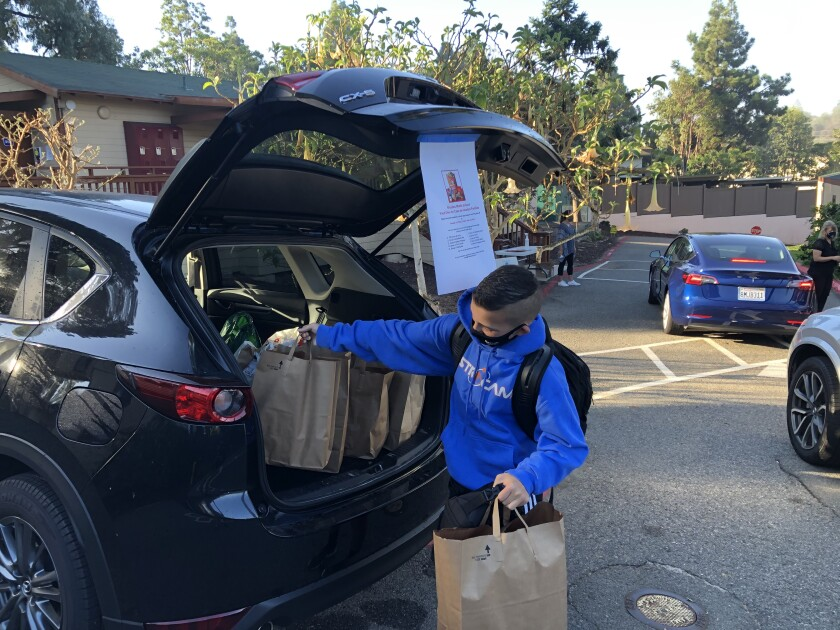 Students at The Rhoades School recently took part in a food and gift card drive to benefit the nonprofit Casa de Amistad.
