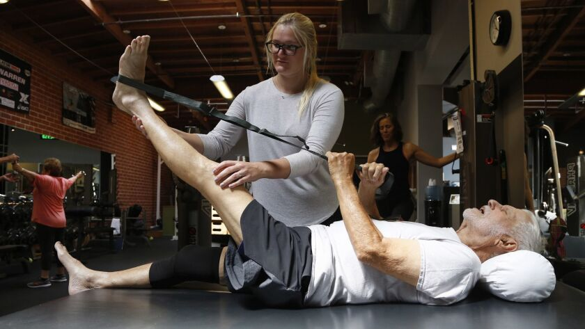 SANTA MONICA, CA- June 12, 2018: Norman Wallack, age 89, works with exercise physiologist Shelby Sto