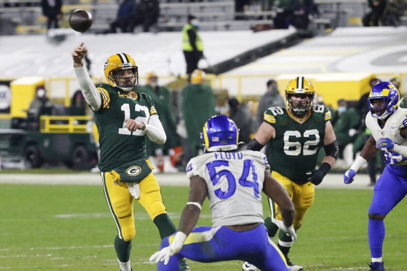 Packers quarterback Aaron Rodgers passes against the Rams during the second half Jan. 16, 2021, in Green Bay, Wis.