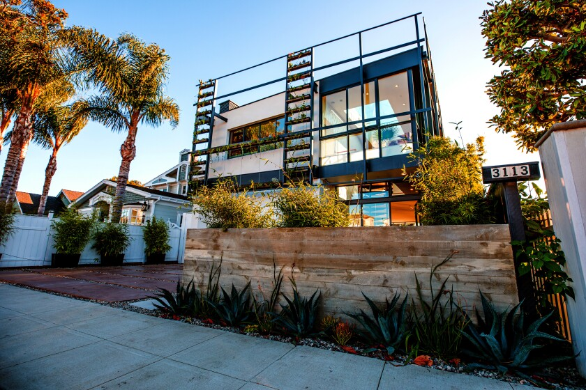 Listed for $3.95 million, the contemporary home in the Oxford Triangle area of Venice features 89 windows and vertical gardens that extend up the front. The multilevel house, 2015, was designed by local eco-conscious homebuilder Jason Teague as his personal family residence. Inside, a textured wall serves as a divider between the bedrooms and living spaces. The kitchen a