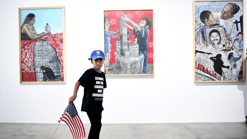 LOS ANGELES, CALIFORNIA MAY 28, 2018-Elijah Goodspeed,6, carrries the American flag while touring th