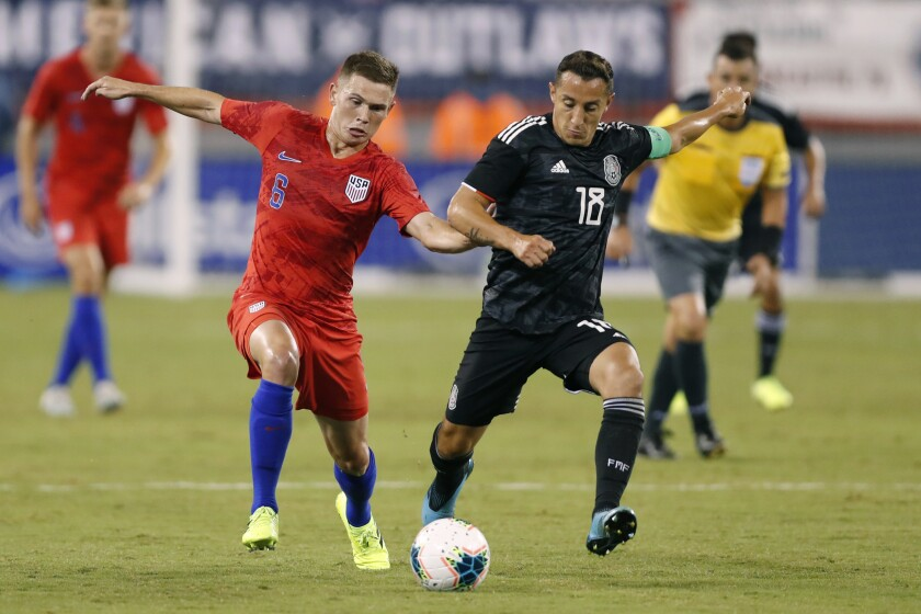 United States midfielder Wil Trapp (6) competes againt Mexico midfielder Andres Guardado (18) in the first half Friday.