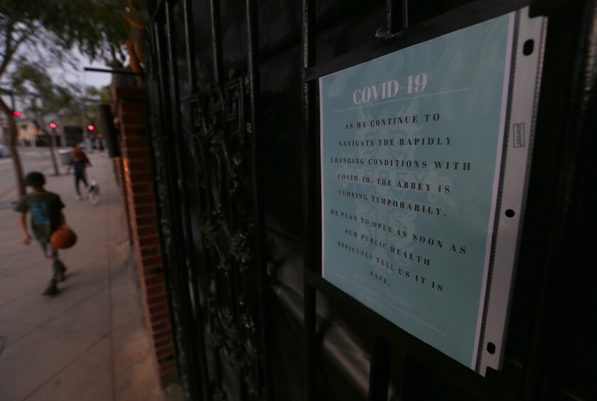 A sign at the Abbey in West Hollywood announces its temporary closure.