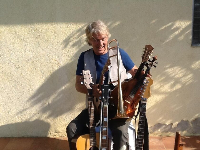 Craig Newton performs a wide variety of instruments as part of a free concert July 8 at La Jolla's Riford Library.