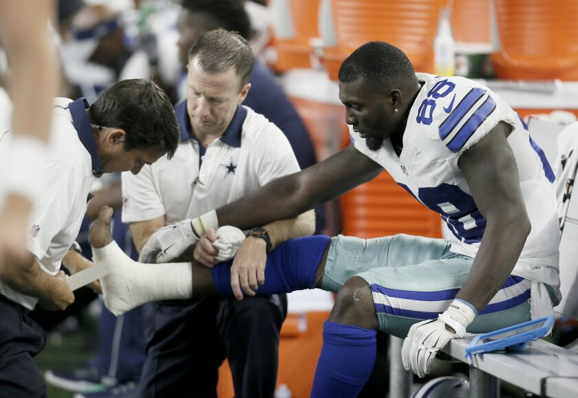 b495bf744 Dallas Cowboys wide receiver Dez Bryant (88) is tended to on the sideline  after