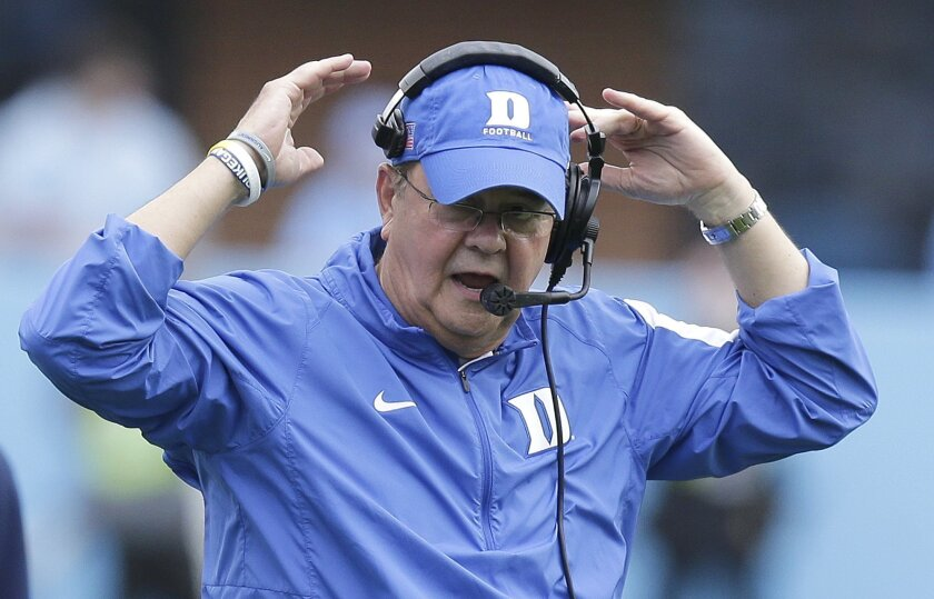 Duke coach David Cutcliffe reacts during the first half of an NCAA college football game against North Carolina in Chapel Hill, N.C., Saturday, Nov. 7, 2015. North Carolina won 66-31. (AP Photo/Gerry Broome)