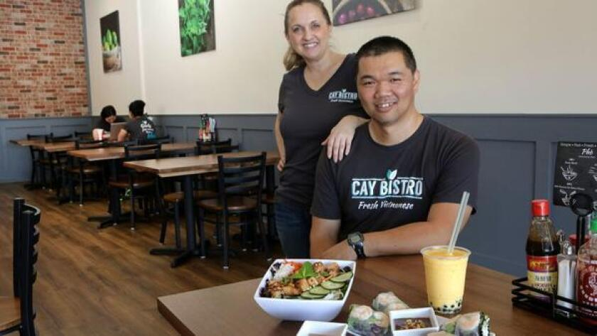 Tan and Marya Chuong inside their newly opened San Marcos restaurant Cay Bistro, which aims to simplify, modernize and localize Vietnamese food. (Bill Wechter / Union-Tribune)