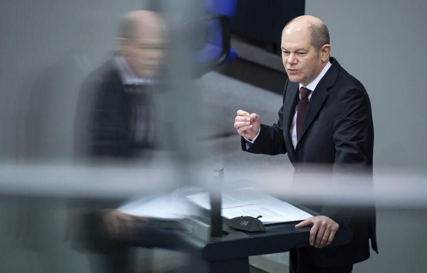 German Finance Minister Olaf Scholz delivers his speech during a session of German parliament Bundestag in Berlin, Thursday, Feb. 25, 2021. (Bernd von Jutrczenka/dpa via AP)