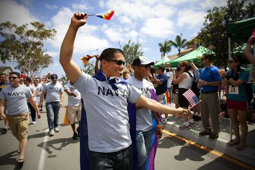 At last year's San Diego Pride parade, active-duty sailors marched wearing Navy t-shirts.