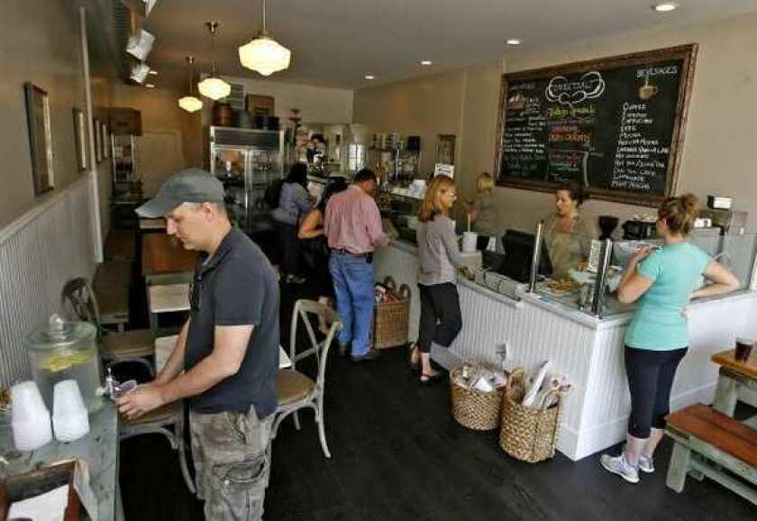Customers place their orders at the Sweet Salt Food Shop on Riverside Drive in Toluca Lake, on Thursday.