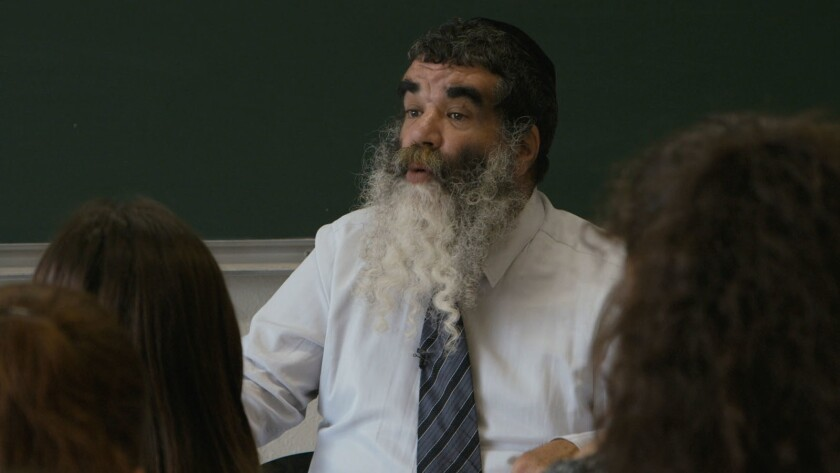 FRANCOIS, the Teacher. Lives in the Jewish section of Sarcelles, a suburb of Paris, teaches at a Jew