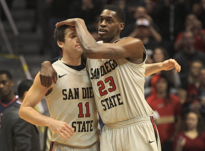 DeShawn Stephens and James Rahon share a moment in the second half as the Aztecs pulled away from Fresno State.