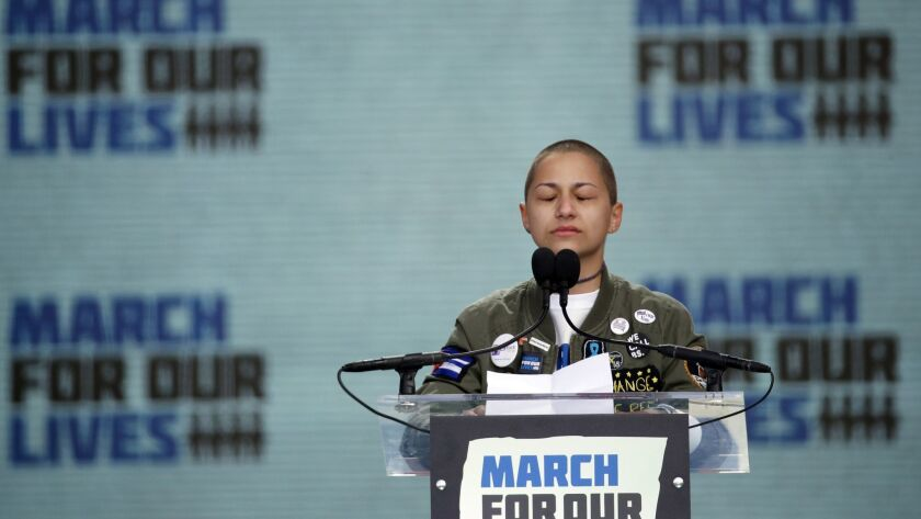 """Parkland shooting survivor Emma Gonzalez stands silently and cries at the podium of the """"March for Our Lives"""" rally in Washington on March 24."""