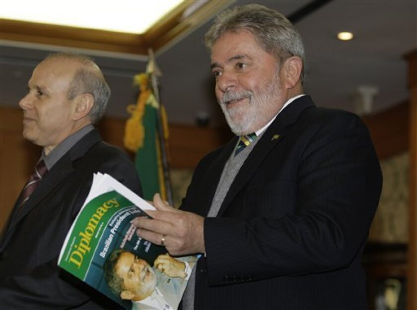 Brazil's President Luiz Inacio Lula da Silva , right, heads to his press conference at the G20 Business Summit in Seoul, South Korea,  Thursday, Nov. 11, 2010.  World leaders are coming together in Seoul Nov. 11-12 to discuss the state of the global economy as it emerges from the financial crisis.