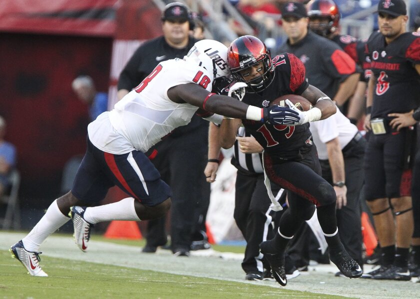 The Aztecs' D.J. Pumphrey is pushed out of bounds by South Alabama's Bull Barge during the second quarter at Qualcomm Stadium on Saturday. Photo by Hayne Palmour IV/San Diego Union-Tribune/Mandatory Credit: HAYNE PALMOUR IV/SAN DIEGO UNION-TRIBUNE/ZUMA PRESS San Diego Union-Tribune Photo by Hayne Palmour IV copyright 2015