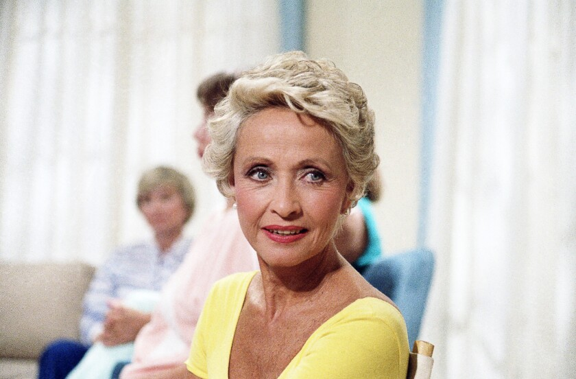"""FILE - In this July 1986 file photo, Actress Jane Powell poses for a photo in New York. Jane Powell, the bright-eyed, operatic-voiced star of Hollywood's golden age musicals who sang with Howard Keel in """"Seven Brides for Seven Brothers"""" and danced with Fred Astaire in """"Royal Wedding,"""" has died. Thursday, Sept. 16, 2021. She was 92. (AP Photo/Richard Drew, File)"""