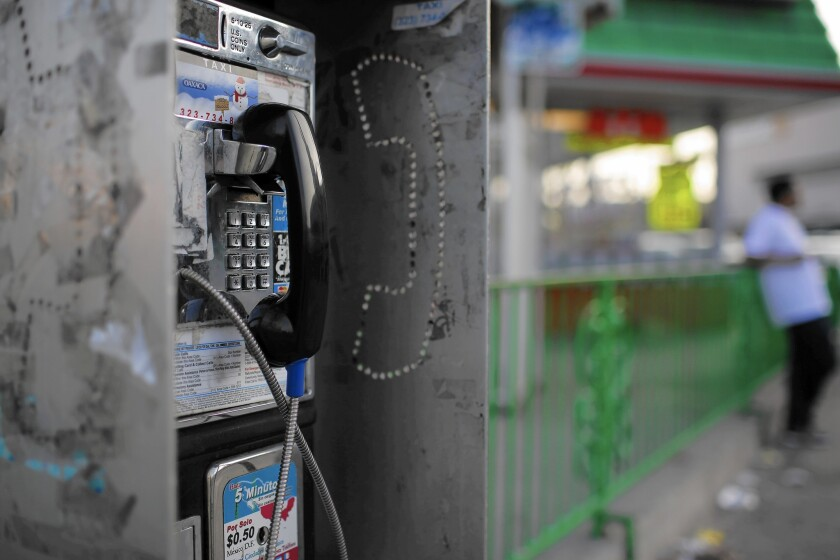 A pay phone at Martin Luther King Boulevard and Crenshaw Boulevard in Los Angeles. Statewide, the number of pay phones has decreased by more than 70% since 2007. But there are still thousands left.